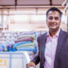Business, India, Factory - Young Businessman Standing at his Factory and Looking at the Camera for a Portrait